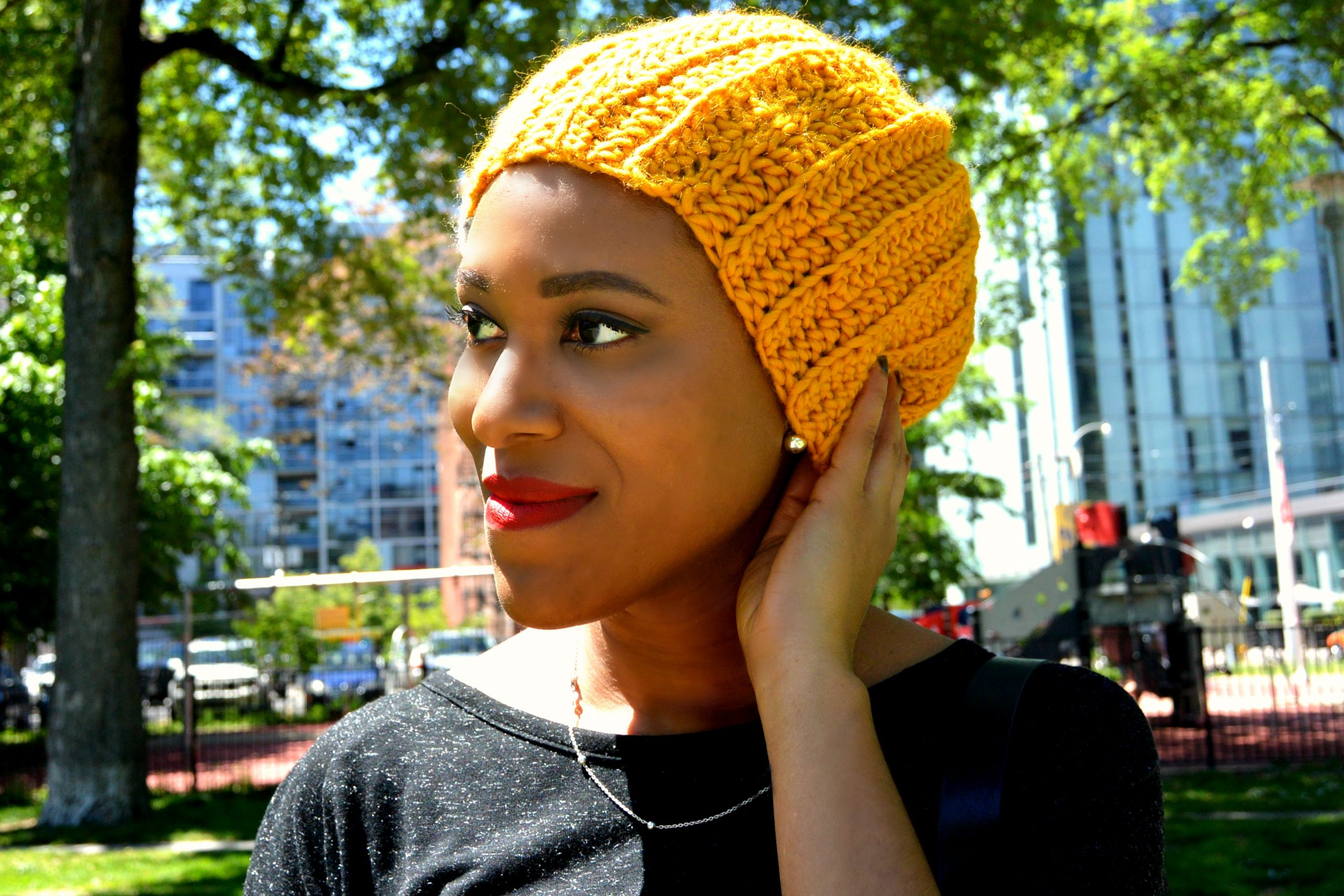 Tricots Knits Founder, José Esdaile wearing one of her creations.